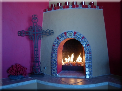 traditional mexican style fireplace with fire glass